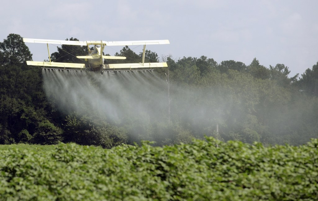 Image: In this Aug. 4, 2009 file photo, a crop duster sprays a field of crops just outside Headland, Alabama.