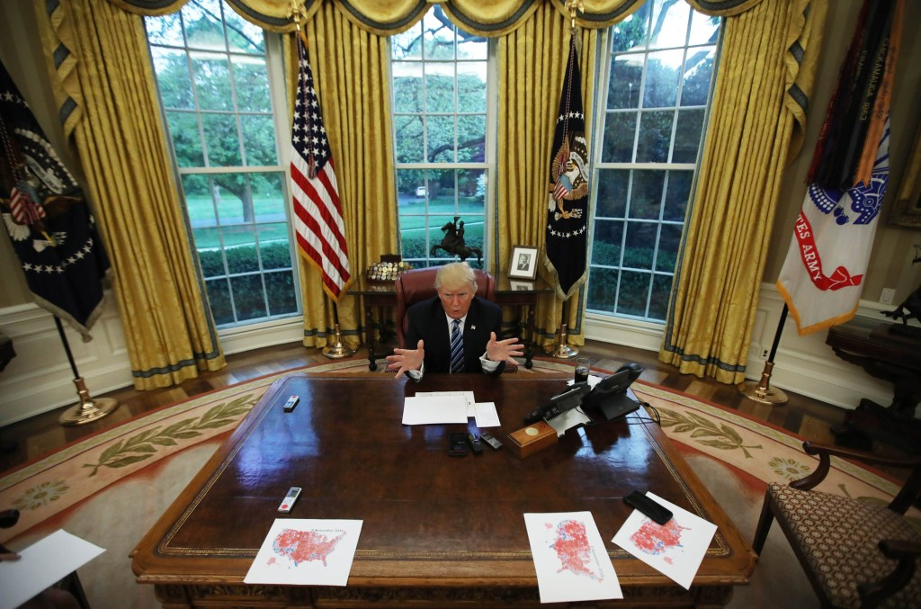 Image: President Donald Trump speaks during an interview with Reuters in the Oval Office of the White House in Washington