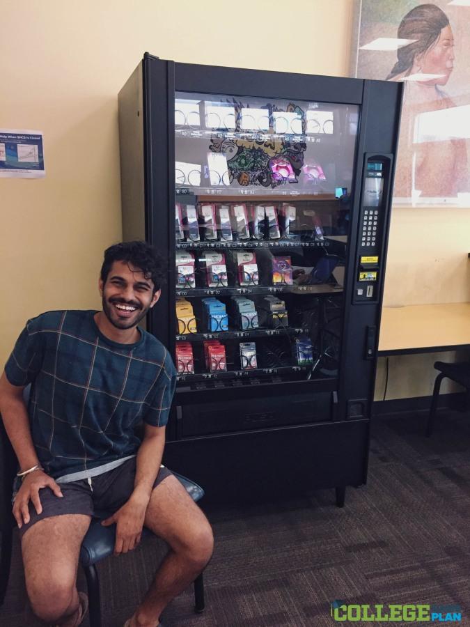 Image: Parteek Singh sits by UC Davis' Plan B vending machine.