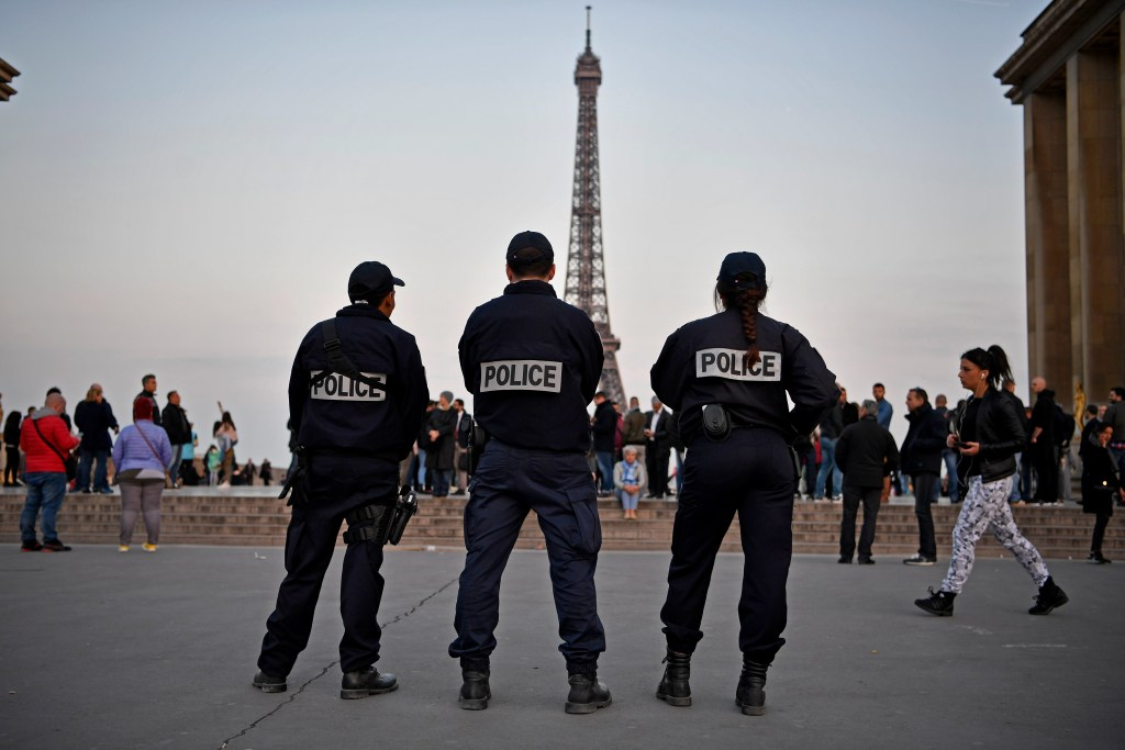 Image: Police stand in front of the Eiffel Tower in Paris