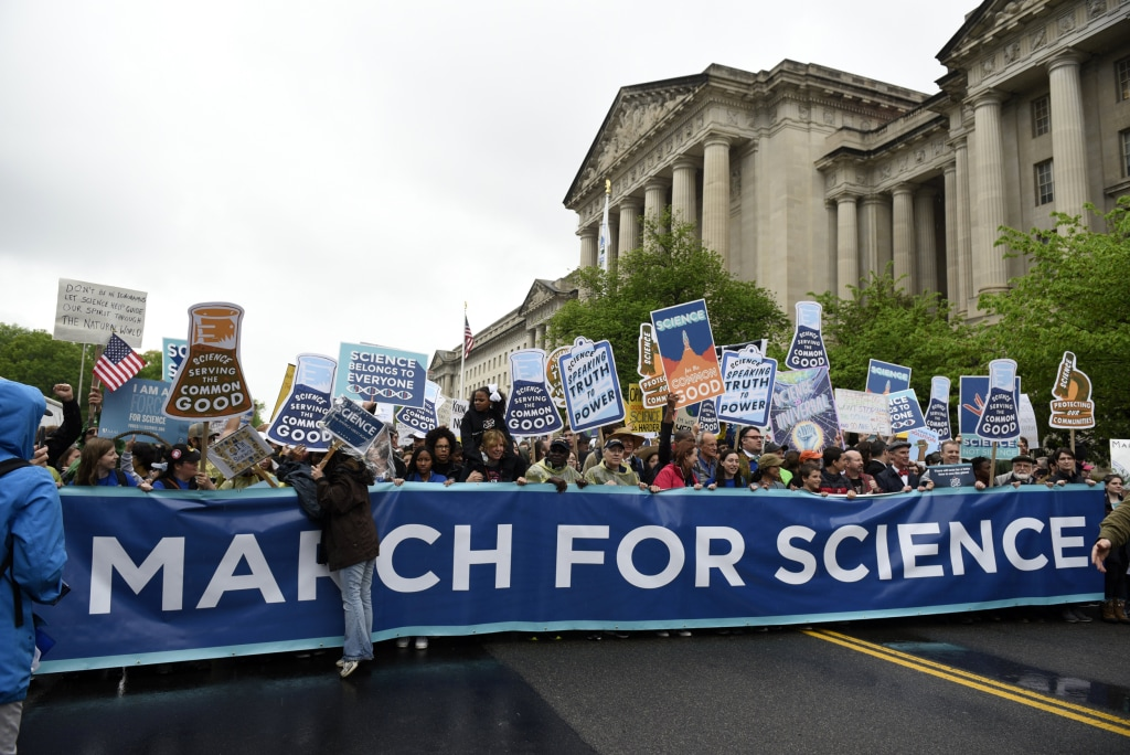 Image: People carry a March for Science banner and signs as they pass the U.S. Environmental Protection Agency during the March For Science in Washington, DC, April 22, 2017.