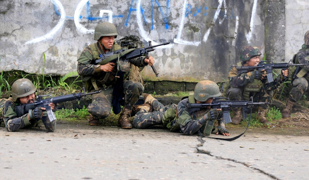 Image: Government troops are seen during an assault on insurgents from the so-called Maute group, who have taken over large parts of Marawi City, in Marawi City