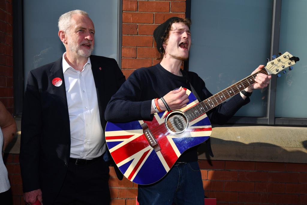 Image: Labour Party leader Jeremy Corbyn meets busker Dan Hetfield in Manchester