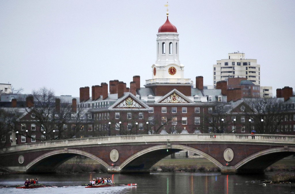 Image: Rowers paddle along the Charles River past Harvard