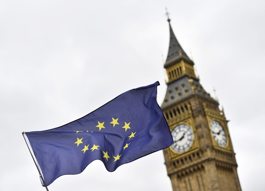 Image: A European Union flag in front of the UK Parliament