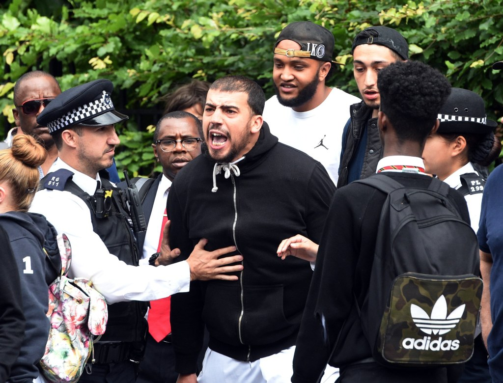 Image: Tempers are frayed near Grenfell Tower, the 24-floor block that was burned out in a fire in London