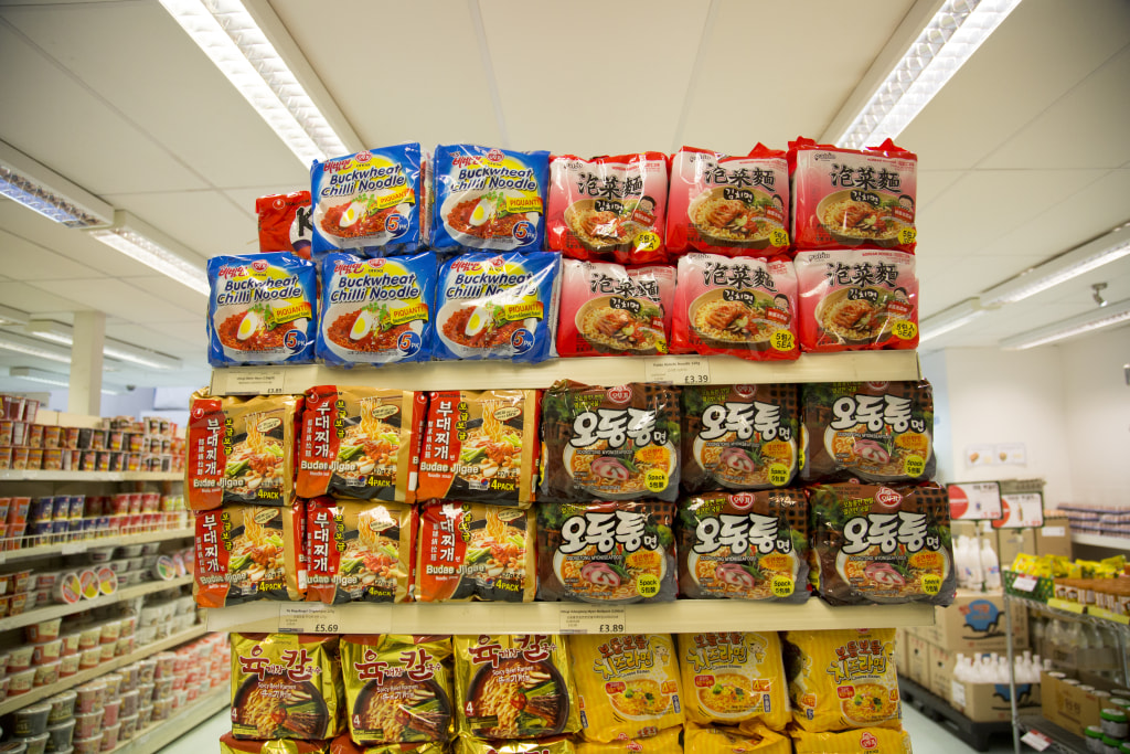 Image: An array of colorful packaging at the Korea Foods superstore in New Malden, London