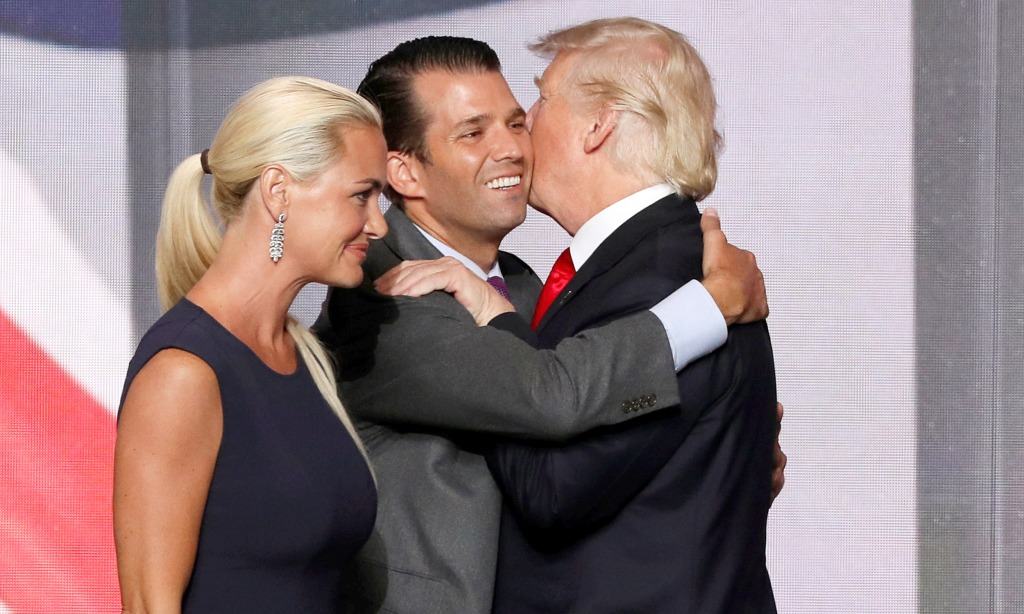 Image: Donald Trump Jr. hugs his father at end of 2016 Republican National Convention in Cleveland