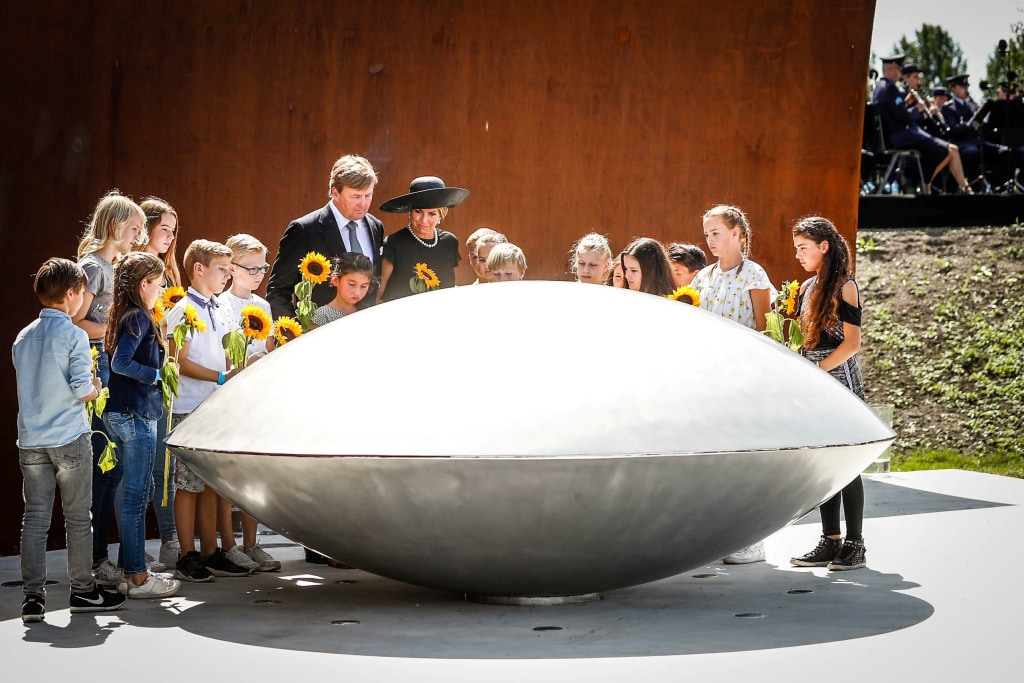 Image: King Willem-Alexander and his wife Queen Maxima of the Netherlands attend an event to unveil a national monument to commemorate the victims of the Malaysia Airlines crash in Ukraine in 2014 in Vijfhuizen
