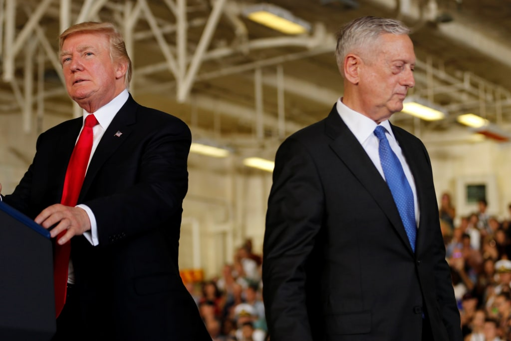 Image: Trump is introduced by Mattis during the commissioning ceremony of the aircraft carrier USS Gerald R. Ford at Naval Station Norfolk in Norfolk, Virginia