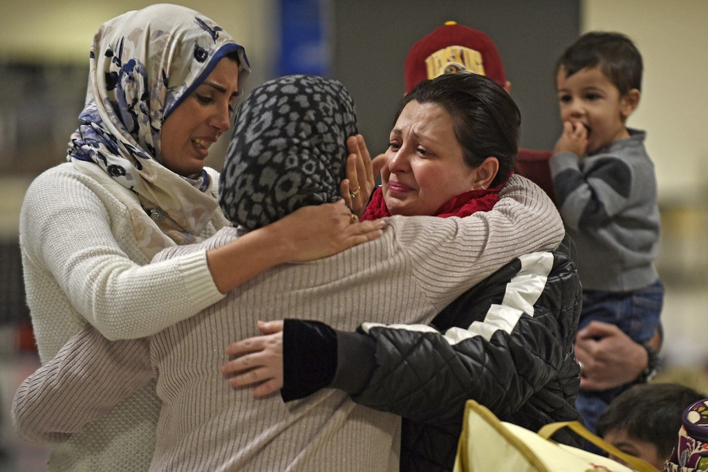 Image: An Iraqi family welcomes their grandmother at Dulles International Airport