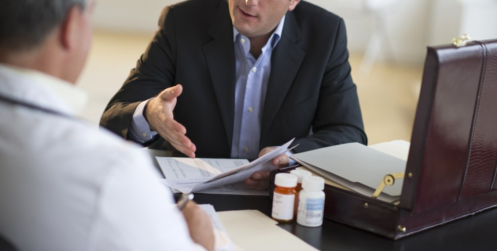 Image: Medical sales representative talking with doctor in office