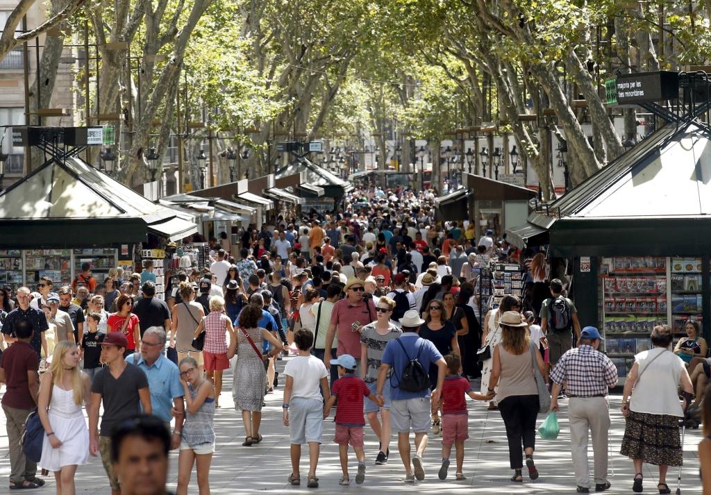 Image: FILE PHOTO: People walk by Las Ramblas in Barcelona