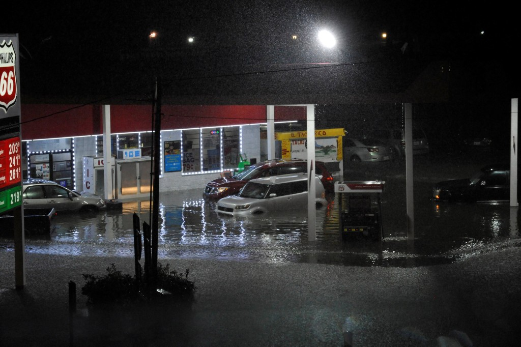 Image: Cars sit abandoned at a flooded gas station after Hurricane Harvey made landfall on the Texas Gulf coast and brought heavy rain to the region