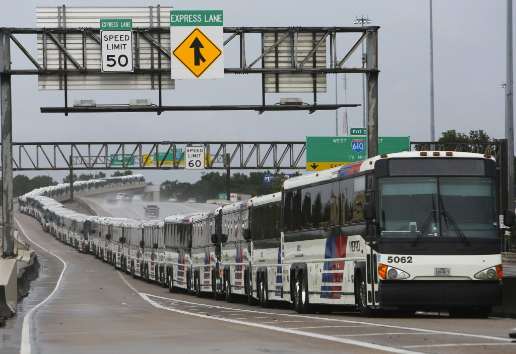 Image: Empty city buses line up on Interstate 59 near Houston Saturday in case their bus shelters flood from Hurricane Harvey