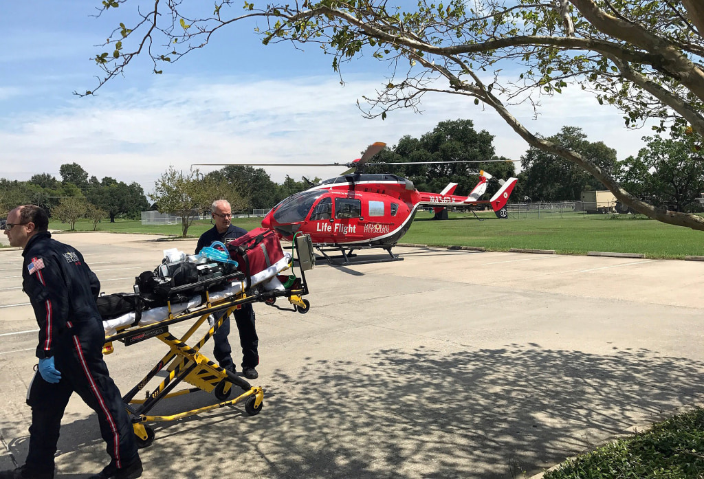 Image: Life Flight, a critical care air medical transport service is seen assisting evacuation due to lack of running water at the Baptist Beaumont Hospital, in southeast Texas