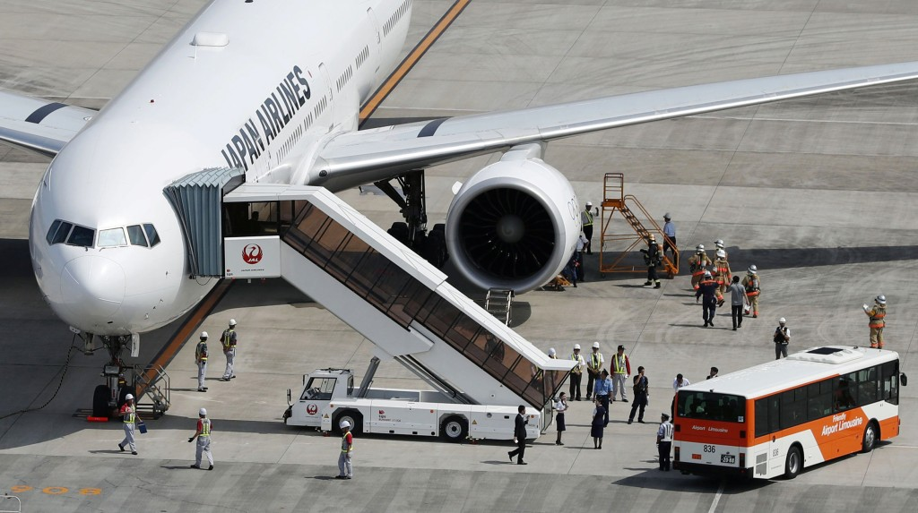 Image: A Japan Airlines plane bound for New York that returned to Tokyo's Haneda airport for an emergency landing due to engine trouble, is seen in Tokyo