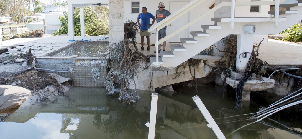 Image: People survey the damage to their homes by Hurricane Irma in Islamorada, in the Florida Keys