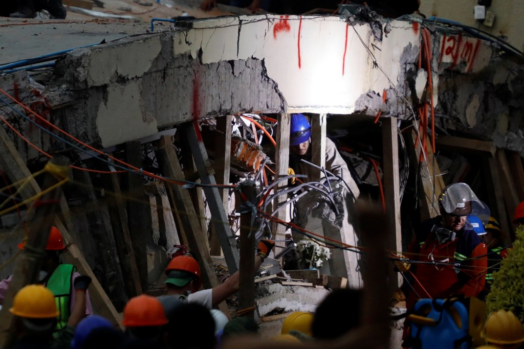 Image: Rescue workers search through the rubble for students at Enrique Rebsamen school after an earthquake in Mexico City