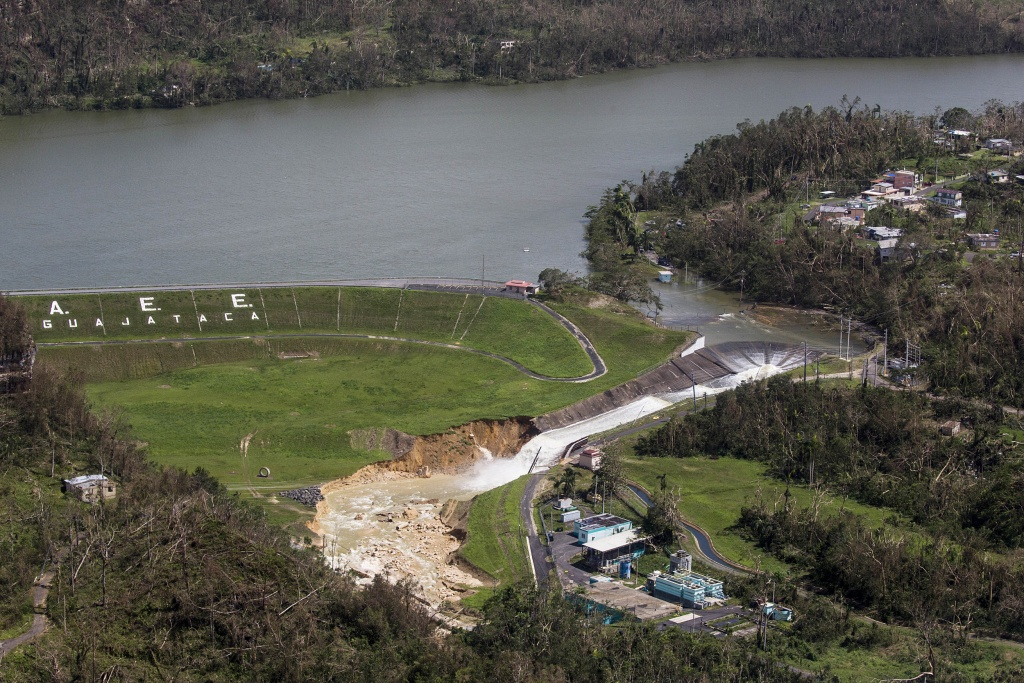 Image: Water drains from the Guajataca Dam in Quebradillas