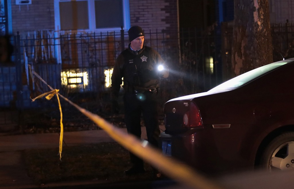 Image: Police investigate the scene of a shooting in Chicago on Jan. 1, 2017. The shooting of two people brought the number of people shot in Chicago to 4000 people in 2016-- one of the most violent years in the city in two decades.