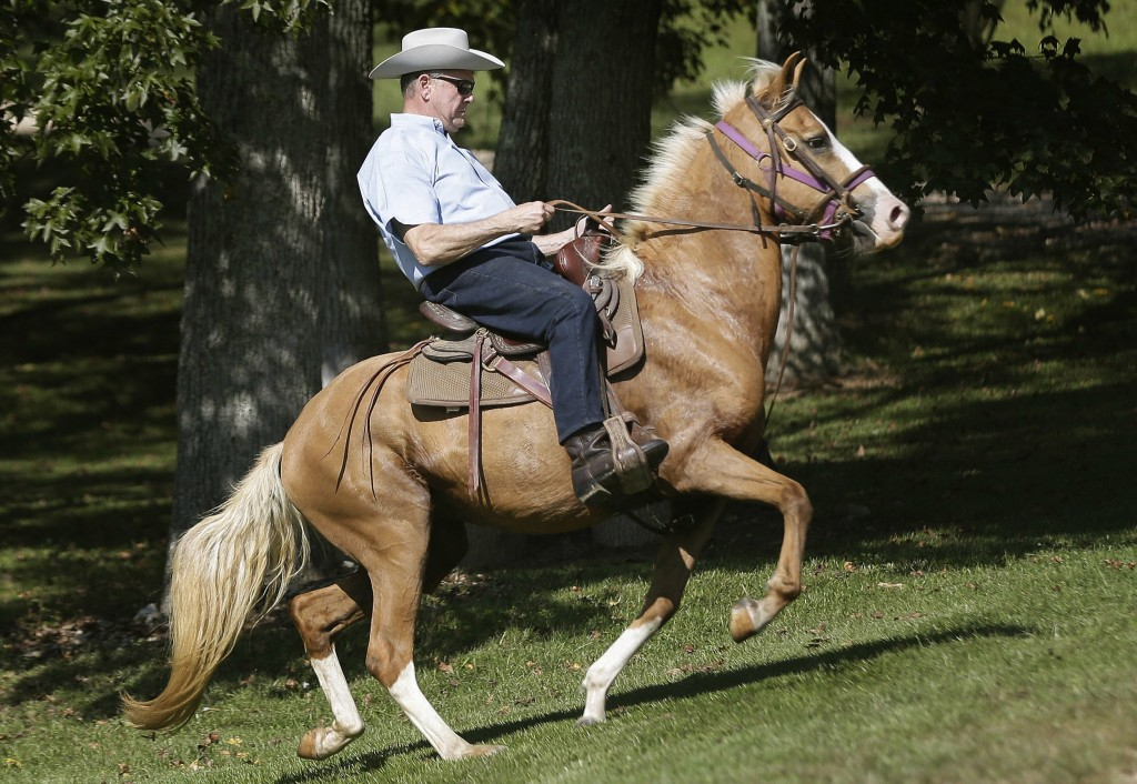 Image:  Moore rides in on a horse to vote at the Gallant Volunteer Fire Department during the Alabama Senate race