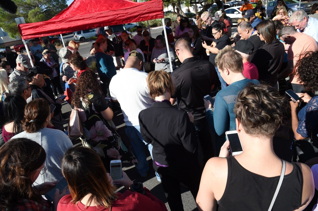 Image: A large group of people gather to donate blood