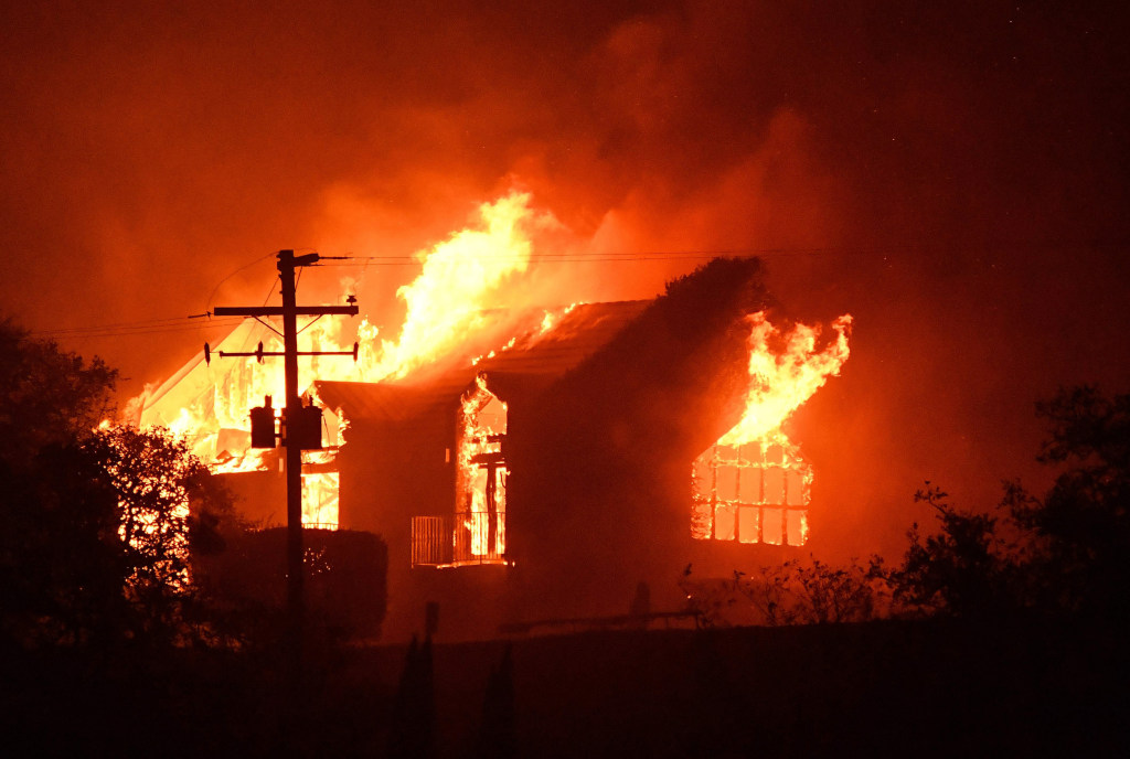 Image: The Signorello Estate winery burns in the Napa wine region of California