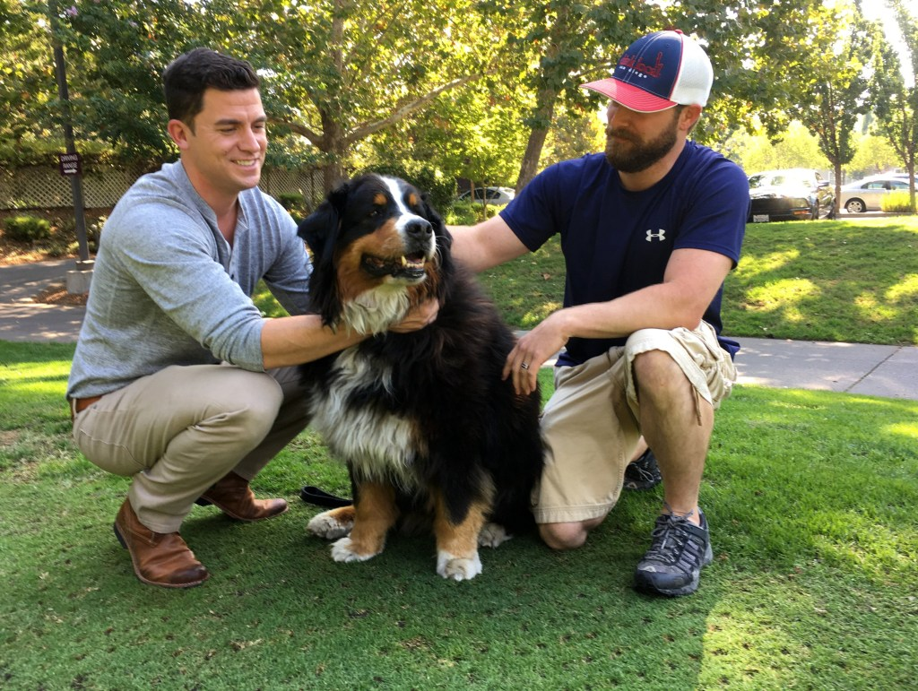 Image: Jack Weaver and his brother in law, Patrick Widen, pose with Izzy, a 9-year-old Bernese Mountain Dog, who belongs to Weaver's parents, Oct. 14, 2017, in Windsor, California.