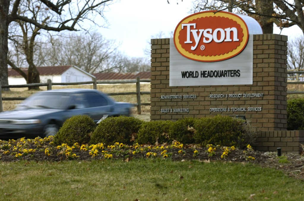 Image: A car passes in front of a Tyson Foods Inc., sign at Tyson headquarters