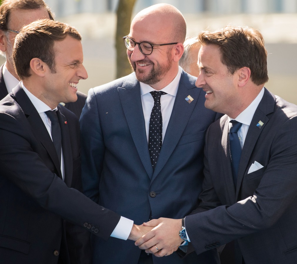 Image: French President Emmanuel Macron, left, with Luxembourg Prime Minister Xavier Bettel, right, and Belgian Prime Minister Charles Michel