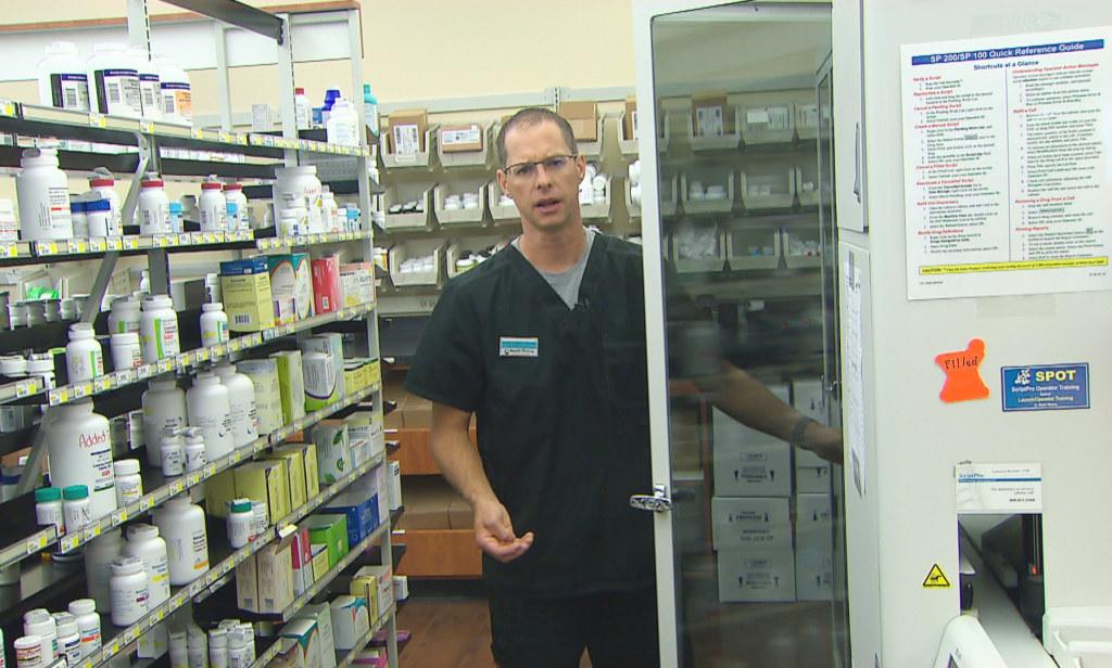 Image: Pharmacist Steve Hoffart inside Magnolia Pharmacy in Magnolia, Texas