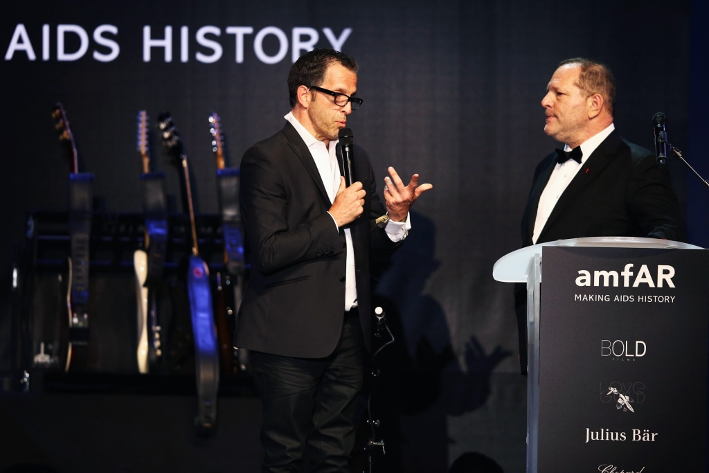 Image: Kenneth Cole, amfAR chairman, and Harvey Weinstein speak on stage at the amfAR's 20th Annual Cinema Against AIDS