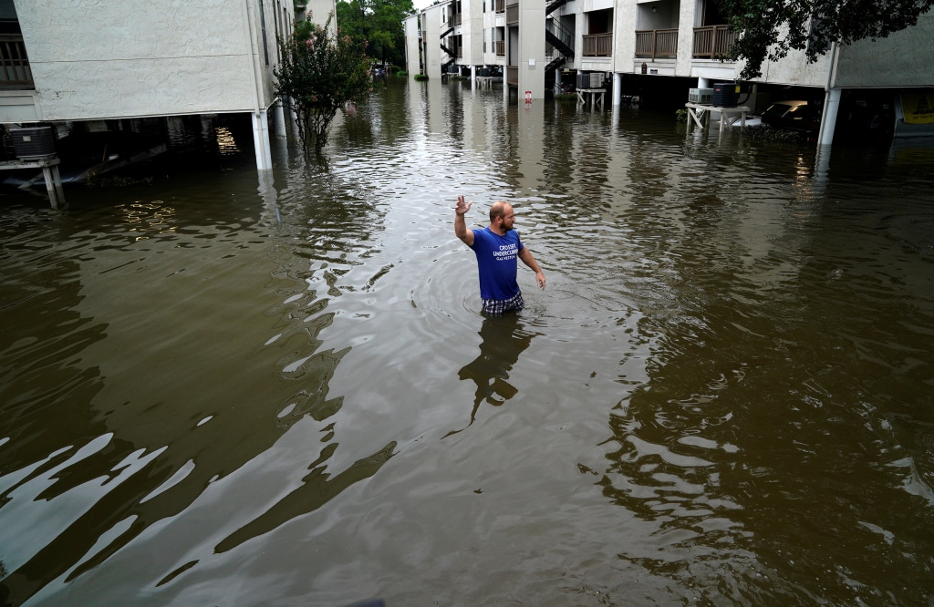 Image: A volunteer looks for people wanting to be evacuated from the Hurricane Harvey floodwaters in Dickinson, Texas, Aug. 28, 2017.