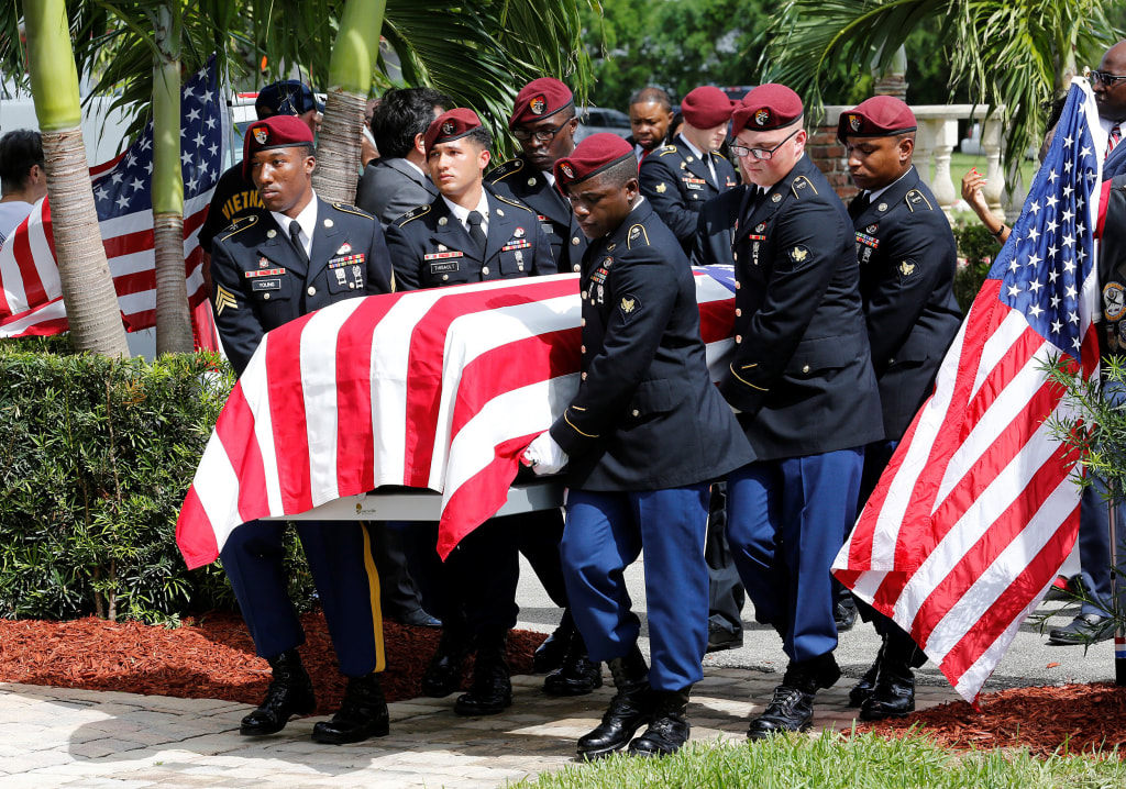 Image: An honor guard carries the coffin of U.S. Army Sergeant La David Johnson, who was among four special forces soldiers killed in Niger, at a graveside service in Hollywood