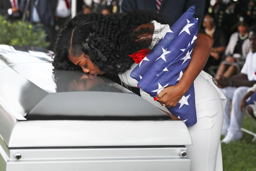Image: Myeshia Johnson kisses the casket of her husband U.S. Army Sgt. La David Johnson