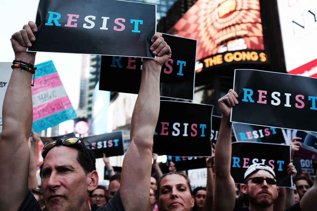 Image: Anti-Trump Protesters Demonstrate In Times Square Against Trump Announcement Of Banning LGBT Service Members