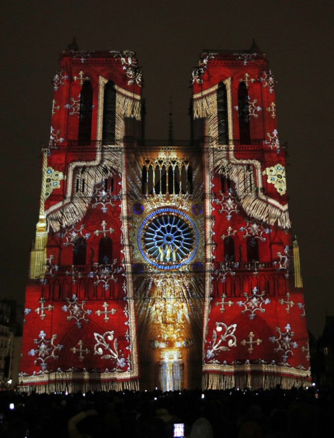 """Image: The Notre Dame cathedral is illuminated during a light show called """"Dame de Coeur"""""""