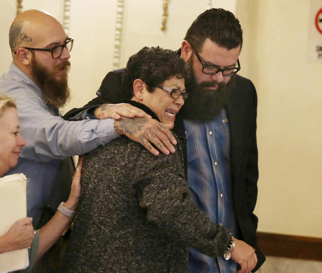 """Image: Christopher """"Jake"""" Carrizal, right, the McLennan County court room with his mother Sonia, left, following a mistrial on Nov. 10, 2017, in Waco, Texas."""
