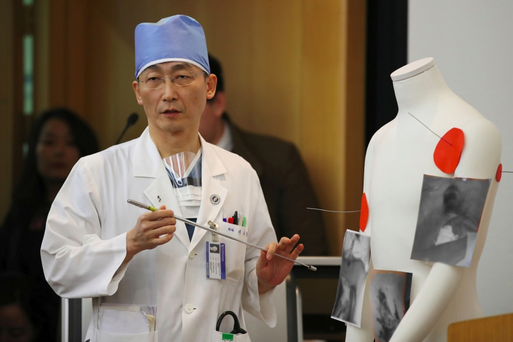 Image: South Korean doctor Lee Cook-Jong speaks about the condition of the North Korean soldier who defected and was found to have parasites in his gut.