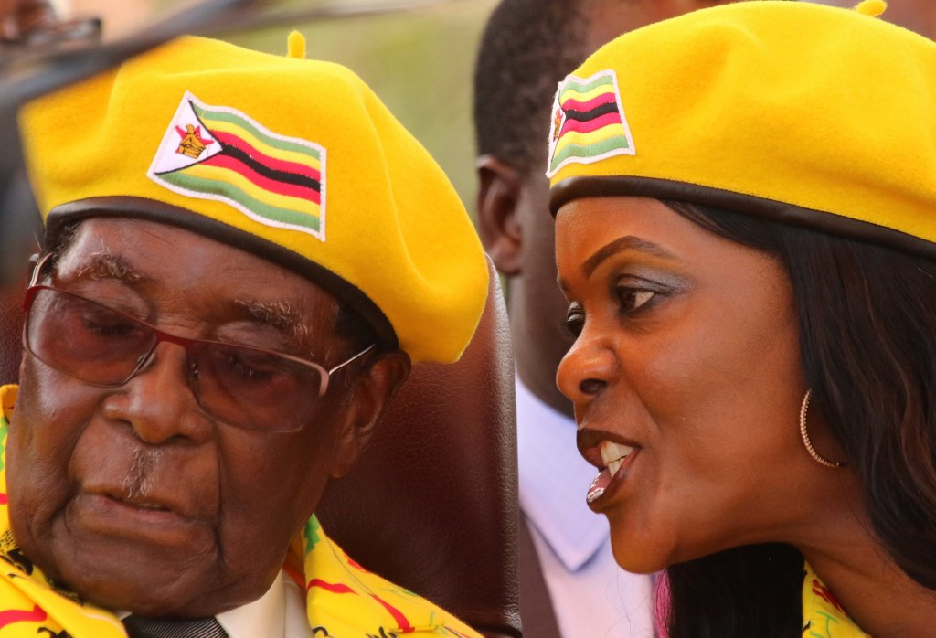 Image: President Robert Mugabe listens to Grace Mugabe at a rally in Harare