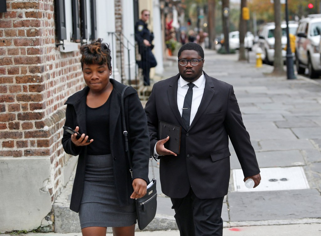 Image: Walter Scott's son Miles Scott leaves the Charleston federal court building after testifying during the 3rd day of the sentencing hearing for former North Charleston policeman Michael Slager in Charleston