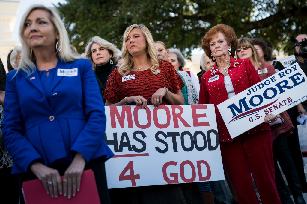 Image: Women attend a 'Women For Moore' rally in support of Republican candidate for U.S. Senate Judge Roy Moore, in front of the Alabama State Capitol, Nov. 17, 2017 in Montgomery, Alabama.