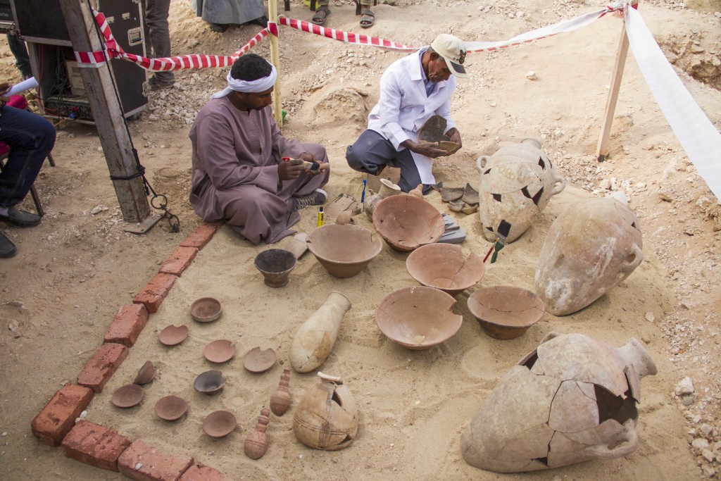 "Image: Egyptian excavation workers restore pottery near a new found in a tomb in Draa Abul Naga necropolis on Luxor's West Bank known as ""KAMPP 161"" in Luxor, Egypt, Dec. 9, 2017."