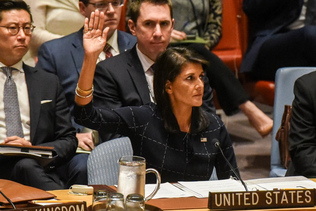 Image: U.S. Ambassador to the UN, Nikki Haley votes during a United Nations Security Council meeting on North Korea in New York City