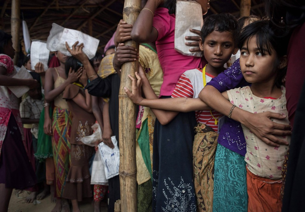 Image: Rohingya refugees wait at a relief center at the Balukhali refugee camp at Cox's Bazar