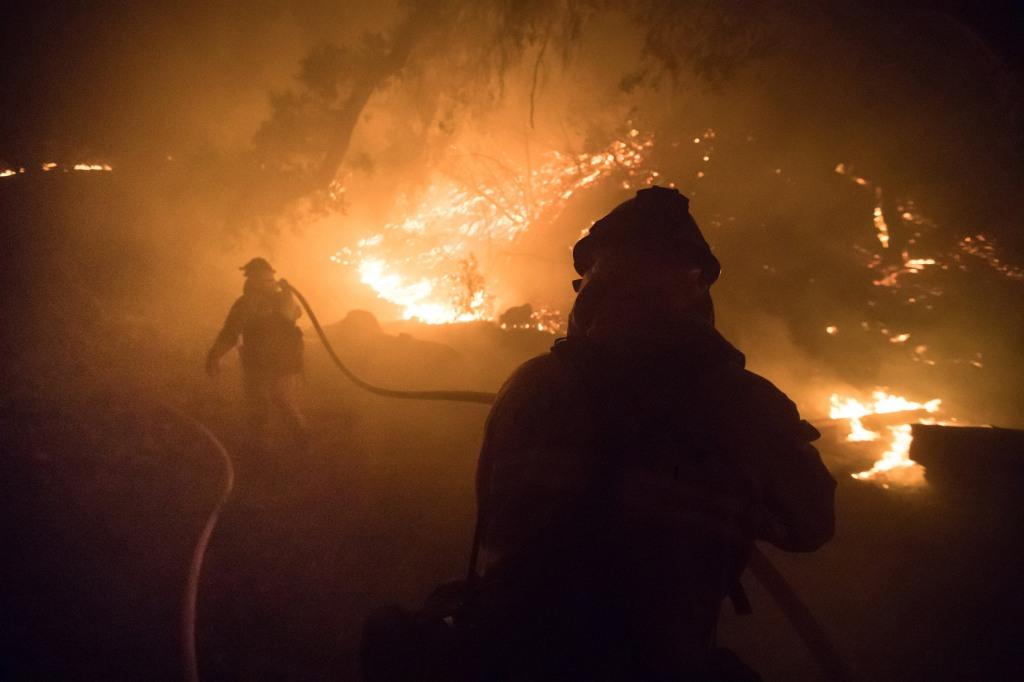 Image: Firefighters battle the blaze on Dec. 15, 2017, in Fillmore, California.