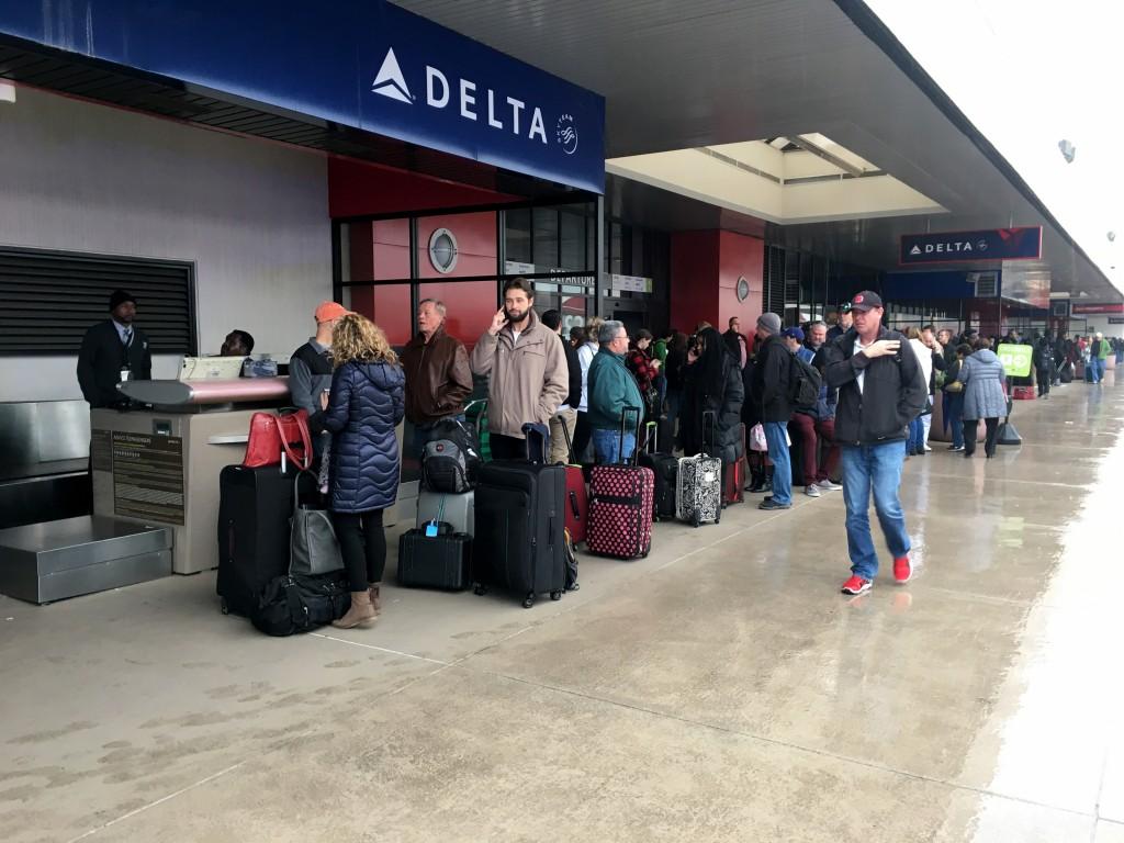 Image: Passengers wait in line at the Atlanta airport, Dec. 17, 2017.