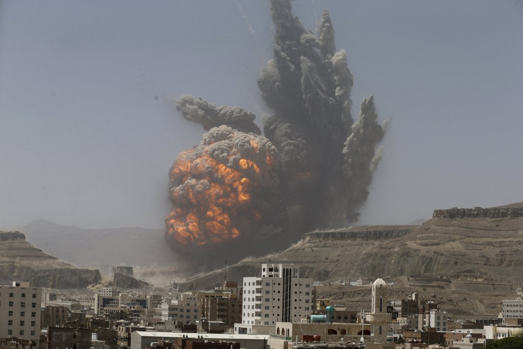 Image: Smoke rises during an air strike on an army weapons depot on a mountain overlooking Yemen's capital Sanaa