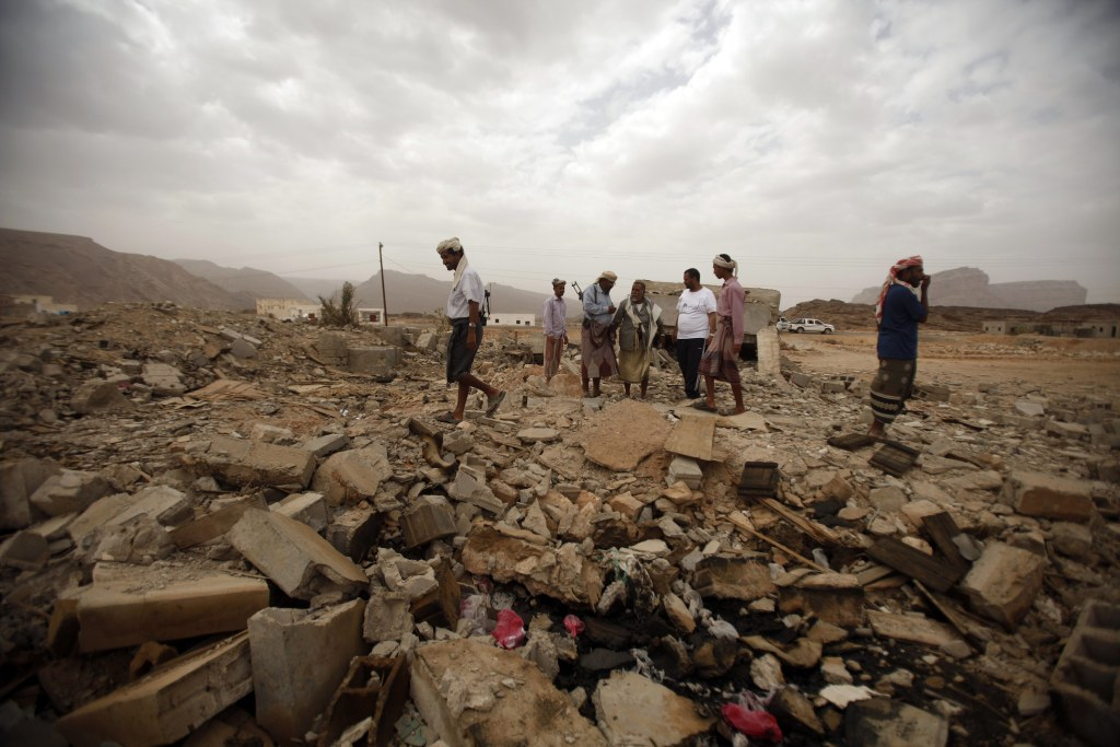 Image: Tribesmen stand on the rubble of a building destroyed by a U.S. drone air strike